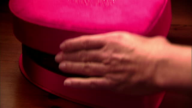 close up zoom out hands taking lid off heart-shaped box of chocolates - valentine stock videos & royalty-free footage