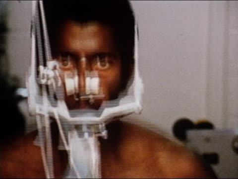 1970 close up zoom out man wearing breathing aparatus and electrodes running on treadmill - respiratory equipment stock videos & royalty-free footage