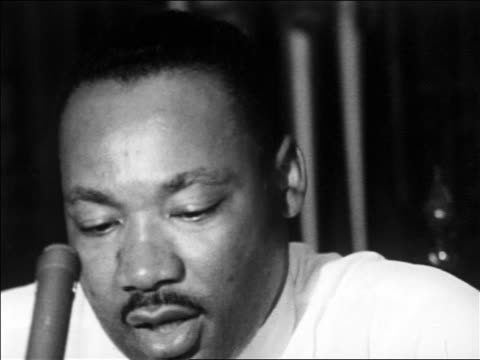 b/w 1965 close up zoom out martin luther king jr giving speech indoors / educational - martin luther religious leader stock videos & royalty-free footage
