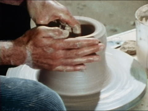 1969 close up zoom out medium shot potter shaping clay on pottery wheel / audio - potter stock videos & royalty-free footage