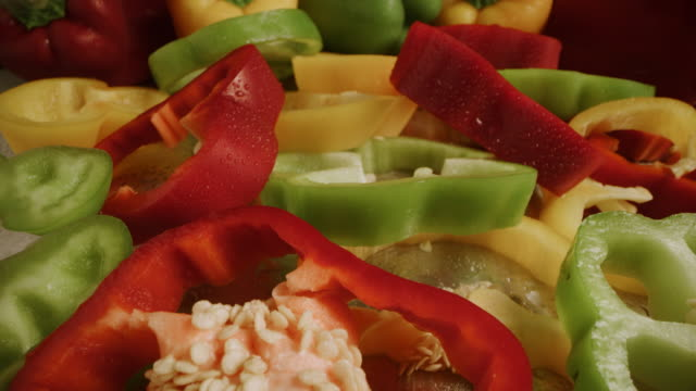 close up zoom out of wet sliced bell peppers / cedar hills, utah, united states - トウガラシ類点の映像素材/bロール