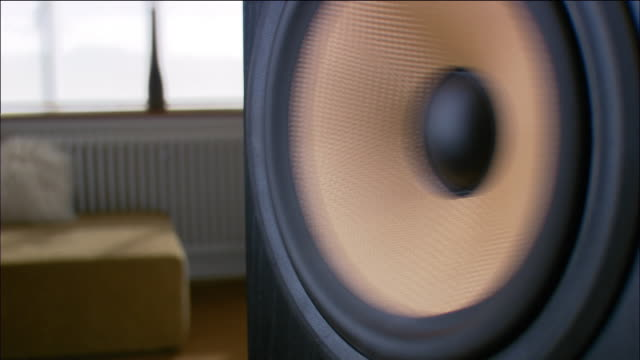 Close up zoom out speaker playing music