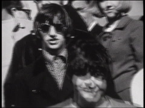 b/w 1964 close up zoom out the beatles wearing sunglasses walking down steps of airplane / san francisco - the beatles stock videos and b-roll footage