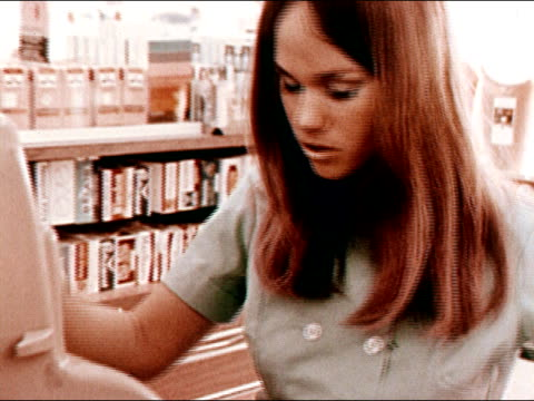 1971 Close up zoom out young woman working as cashier/ California/ AUDIO