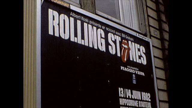 close ups of a poster advertising the rolling stones concert at the hippodrome d'auteuil racetrack on june 13 and 14th 1982. poster also lists bill... - sport venue stock videos & royalty-free footage