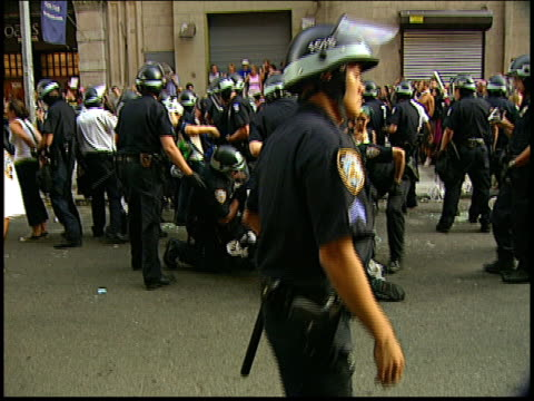 Close ups of arrested protestors in handcuffs sitting at 2004 RNC antiwar protests in NYC Protestors later won a settlement from the NYPD following a...