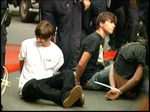 Close ups of arrested protestors sitting with their hands behind their backs at the 2004 RNC antiwar protests in Union Square in NYC Brief shot of...