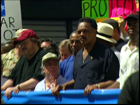close ups of celebrities and activists including michael moore danny glover and jesse jackson leading the 2004 rnc antiwar march in nyc - republican national convention stock videos & royalty-free footage