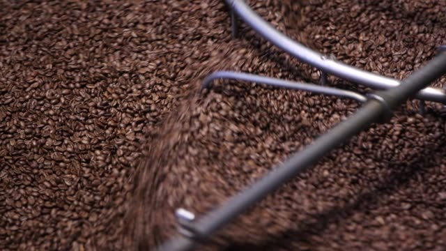 close ups of coffee beans stirring and being roasted at the starbucks reserve roastery and tasting room in seattle wa on october 9 2017 photographer... - スターバックス点の映像素材/bロール