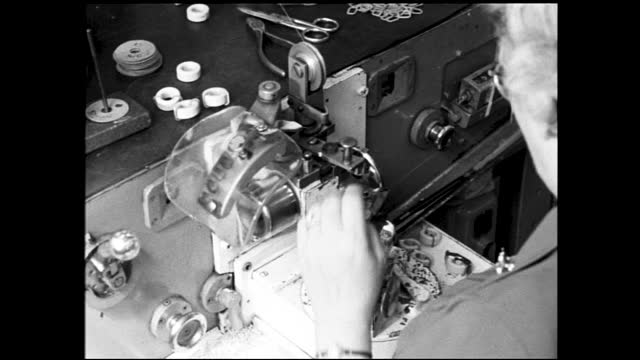 close ups of woman working on spinning machine, table full of small parts behind the machine - 1940 1949 stock videos & royalty-free footage