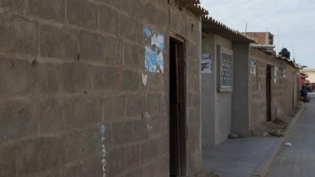 close view at brick houses in tortuga peru - れんが造りの家点の映像素材/bロール