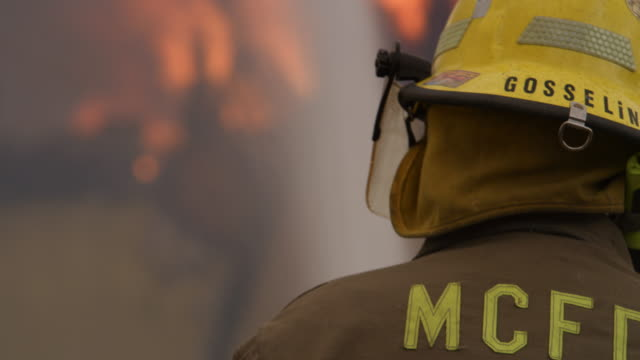 close view of a firefighter spraying a blaze - myrtle creek stock videos and b-roll footage