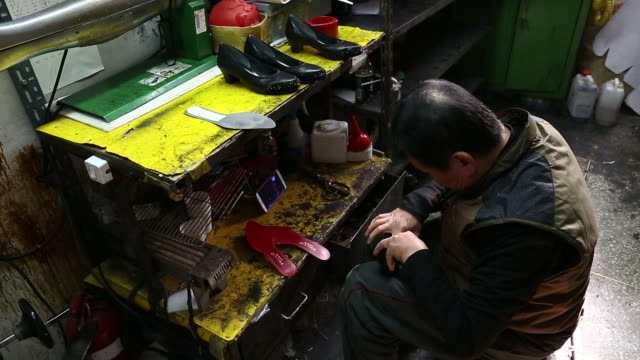 close view of blank shoes a worker adds red shoe pads into shoes an employee packs a pair of shoes into a shoebox - pair stock videos & royalty-free footage