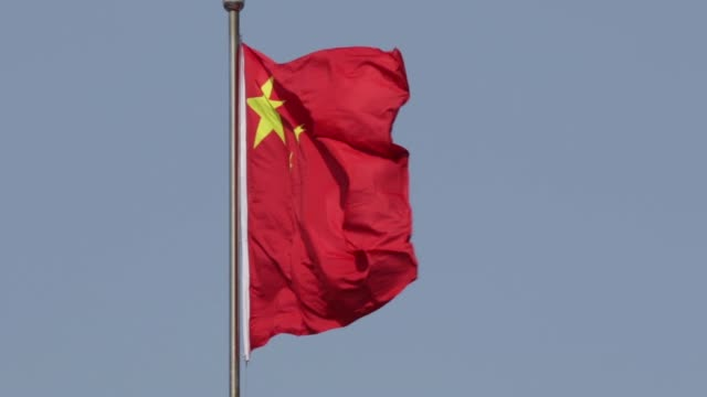 close view of chinese national flag fluttering on a pole red flags fly at tiananmen gate in beijing china on monday march 2 red flags fly in front of... - chinese flag stock videos & royalty-free footage