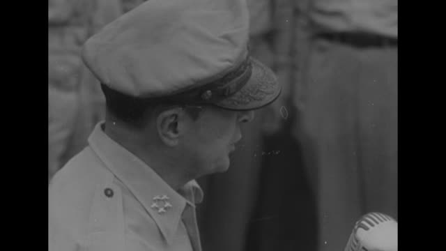 close view of gen douglas macarthur speaking into microphones / japanese foreign minister namoru shigemitsu and japanese delegation standing and... - arrendersi video stock e b–roll