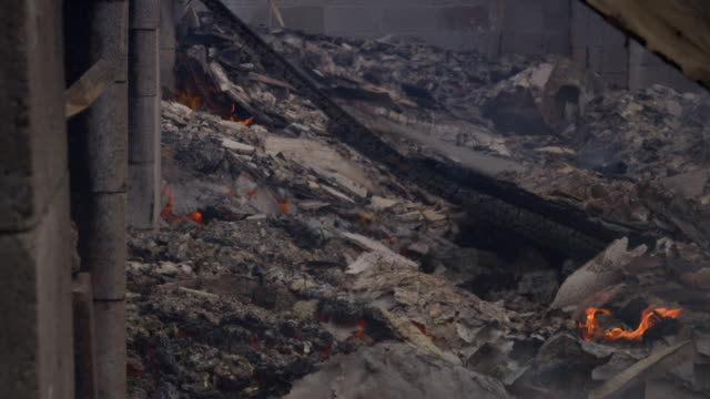 close view of smoldering ash-covered debris in the aftermath of a structure fire - myrtle creek stock videos & royalty-free footage