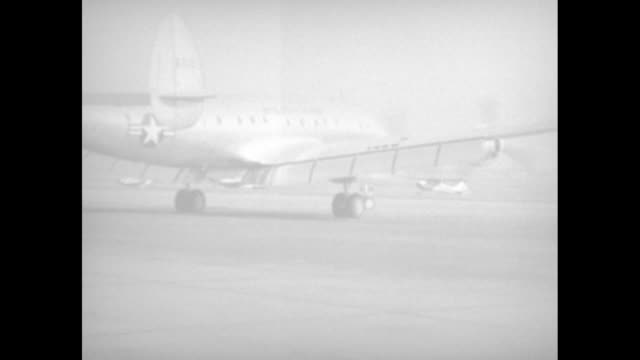 vídeos de stock e filmes b-roll de vs close view of the engine of lockheed vc121e super constellation firing up belching exhaust taxiing and taking off as it transports us secretary of... - 1950