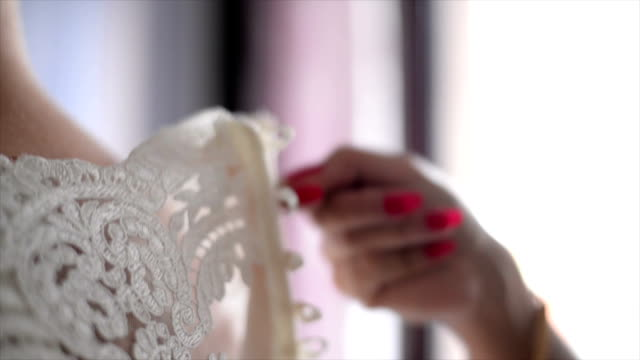 close view of the wedding dress - wedding dress stock videos and b-roll footage