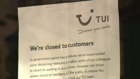 closed branch of travel agent tui in halifax, they are closing a third of their shops as more people book holidays online - sign stock videos & royalty-free footage
