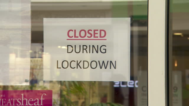 closed businesses during coronavirus lockdown - information sign stock videos & royalty-free footage