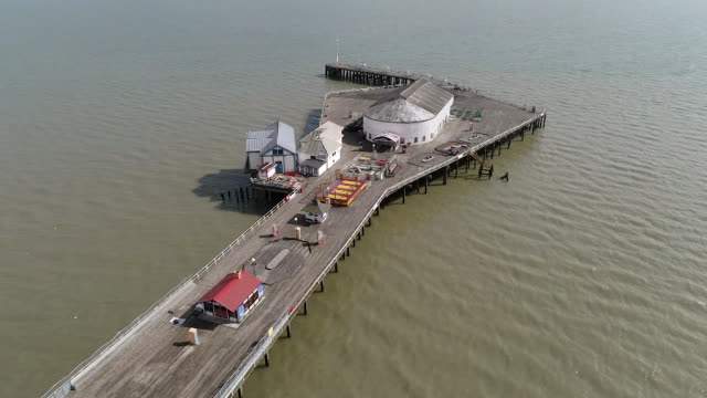 closed down and empty clacton pier in essex due to lockdown during coronavirus crisis - pier stock videos & royalty-free footage