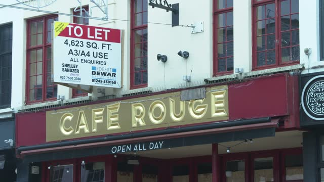 closed down cafe rouge, with an eviction notice on the door and a homeless person sleeping outside on chelmsford high street on december 31, 2020 in... - resting stock videos & royalty-free footage