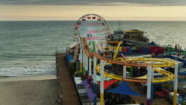closed down rides on santa monica pier during covid-19 lockdown - aerial - pier stock videos & royalty-free footage