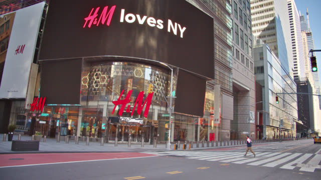 closed h&m and colorful advertisement billboards. deserted new york street during the coronavirus pandemic. lockdown. - high street stock videos & royalty-free footage