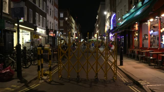 closed off roads and quiet seating areas in soho at steadicam - uk nightlife struggle amid coronavirus pandemic on october 19, 2020 in london,... - nightlife stock videos & royalty-free footage