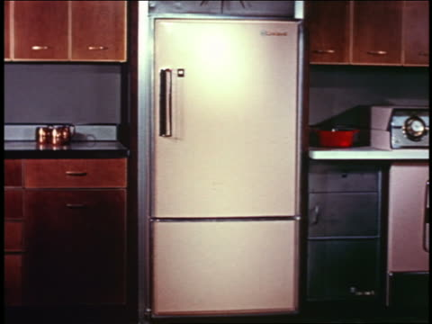 1958 closed refrigerator in kitchen - refrigerator stock videos & royalty-free footage