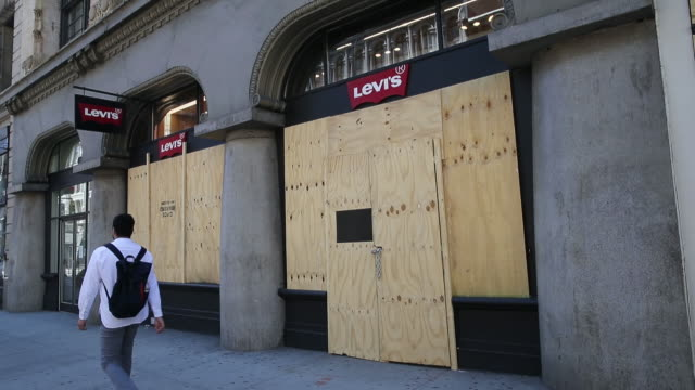 closed retail businesses in manhattan, new york city, ny, u.s. on monday, june 8, 2020. many stores around new york have been boarded up based the on... - levi's stock videos & royalty-free footage