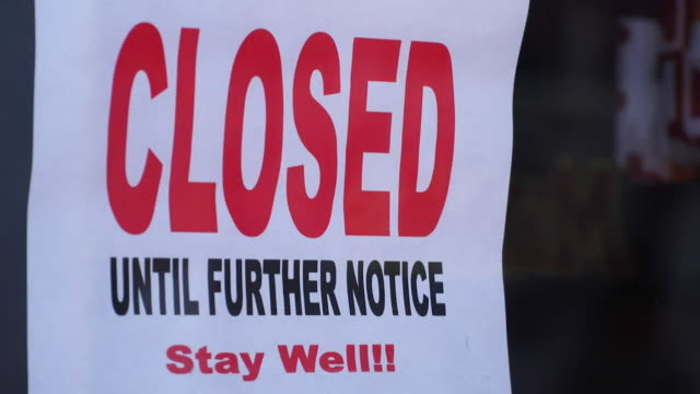 closed shops in annapolis, maryland, due to lockdown during coronavirus pandemic - closed sign stock videos & royalty-free footage