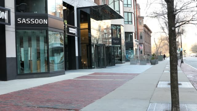 closed shops on newbury street which is a major shopping hub in boston, mass. on march 26, 2020 during the evening commute. governor charlie baker... - back bay boston stock videos & royalty-free footage
