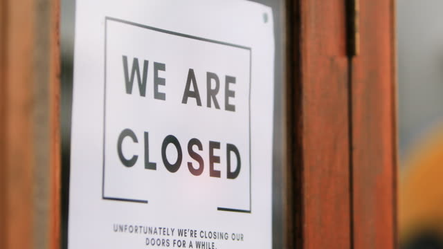 closed sign on retail store during covid-19 - closing stock videos & royalty-free footage