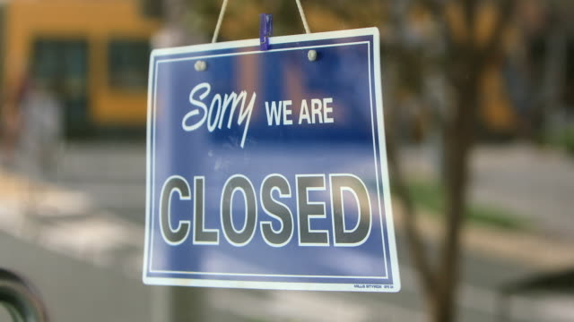closed sign on retail store during covid-19 - australian politics stock videos & royalty-free footage