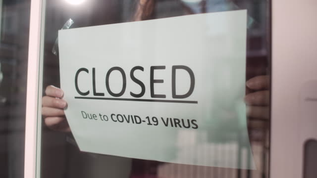 closed sign on shop door due to covid-19 virus, slow motion - closing stock videos & royalty-free footage