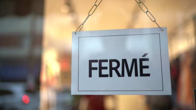 closed sign (fermé) seen through glass by at store - placard stock videos & royalty-free footage