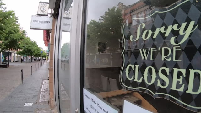 closed signs and shops, empty streets and street benches being disinfected as leicester goes back into lockdown due to spike in local coronavirus... - closed stock videos & royalty-free footage