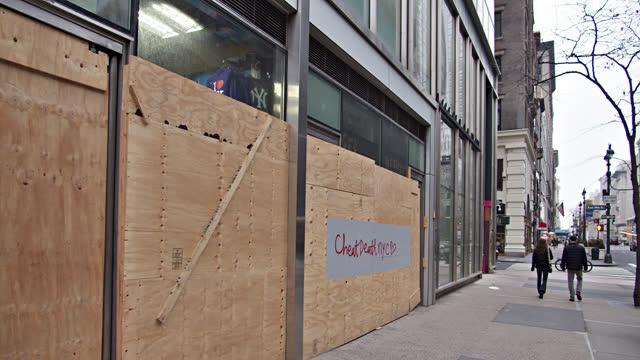 closed store. plywood. new york street. - manhattan new york city stock videos & royalty-free footage
