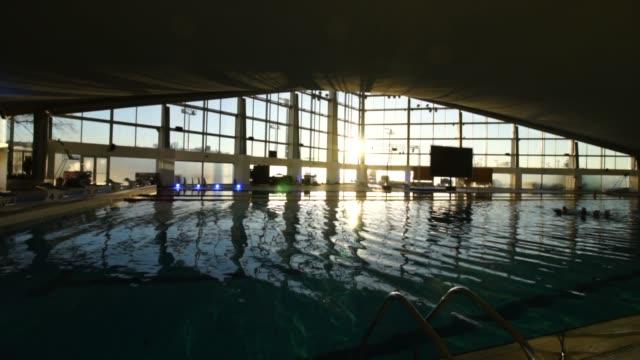 stockvideo's en b-roll-footage met gesloten zwembad bij zonsondergang - stock video - passenger train