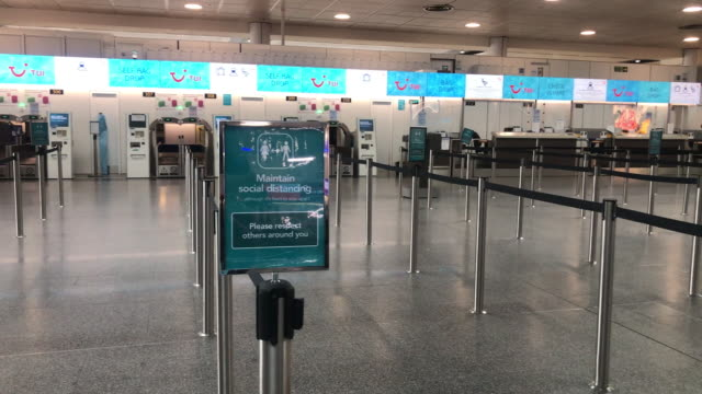closed tui checkin desk at an airport due to coronavirus - empty stock videos & royalty-free footage