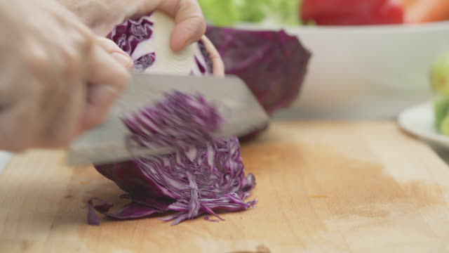 closed up hand chopped purple cabbage on table - chopped food stock videos and b-roll footage