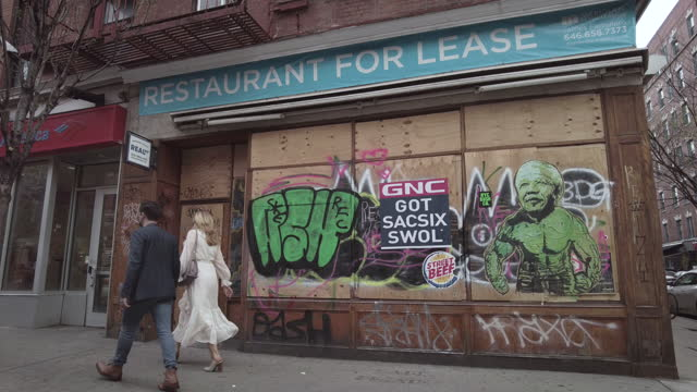 """closed-down restaurant displays a """"for lease"""" sign in greenwich village during the coronavirus pandemic on april 10, 2021 in new york, us. - recession stock videos & royalty-free footage"""