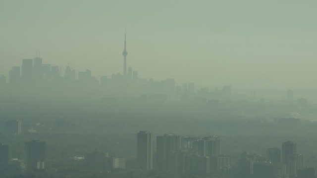 closer shot of the toronto skyline in the early morning in late fall.  hazy and a lot smoggy - smog stock videos & royalty-free footage