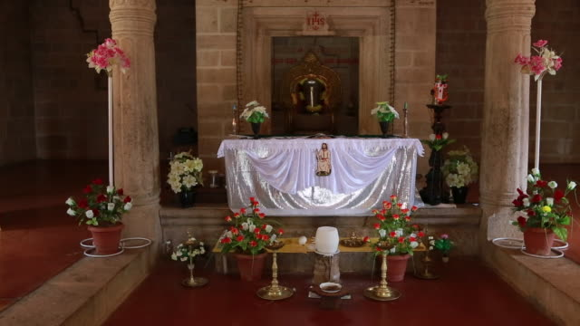 stockvideo's en b-roll-footage met closer shot to the altar and tabernacle inside a catholic church founded by jesuits the church is built in a typical hindu temple style around the... - missiehuis