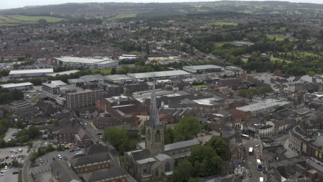 closer view of chesterfield in derbyshire town centre and crooked spire church aerial view anti clockwise orbit - spire stock videos & royalty-free footage