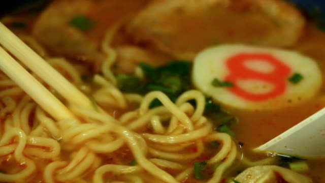close-up a bowl of japanese ramen noodle with water steam pork inside. from bottom to top. - ramen noodles stock videos & royalty-free footage