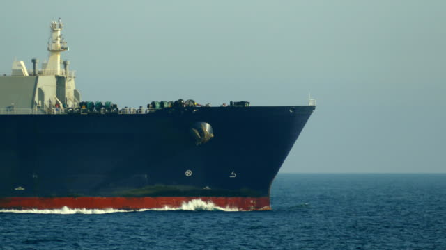close-up - a cargo ship sailing in the atlantic ocean - ship's bow stock videos & royalty-free footage