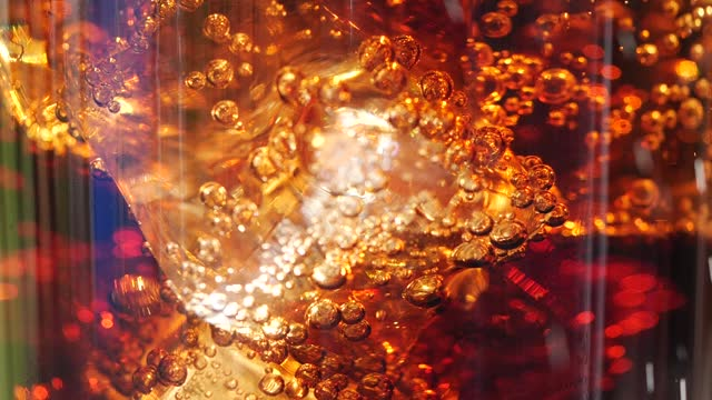 close-up a glass of cola with ice cubes and bubbles - cold drink stock videos & royalty-free footage