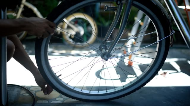 closeup a man inflating bike wheel, pumping air into the flat tire. - fuel pump stock videos & royalty-free footage